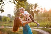 Mother and son having fun outdoors.