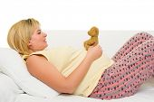 happy pregnant woman on sofa isolated