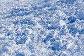 Snow avalanche rushing closeup.
