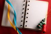 Open Notebook With Ribbons