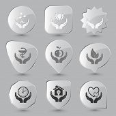 In hands set. Vector glass buttons.