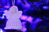 foto of christmas angel  - Knitted Christmas angel on Christmas lights background - JPG