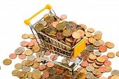 a shopping cart is full with euro coins, symbolic photo for purchasing power and consumption