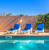 Sun Loungers By The Pool. For Leisure Travelers.