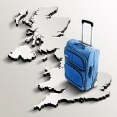Travel To United Kingdom. Blue Suitcase On 3D Map Of The Country