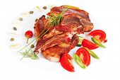 red beef meat steak on white plate with green hot pepper and tomatoes isolated  over white background