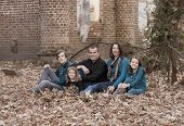 family portrait of five people in autumn setting