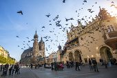 KRAKOW, POLAND - NOV 11, 2014: Unidentified people near the Church of Our Lady Assumed also known as St. Mary's Church at the Main Market Square in Krakow, Poland.