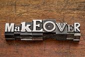 makeover word in mixed vintage metal type printing blocks over grunge wood