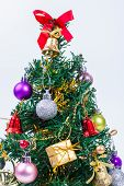 Decorated Christmas Tree On White Paper Background