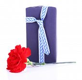 Gift box with red carnation isolated on white background