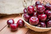 Fresh Red Cherries On Wooden