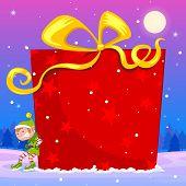 Elf pushing big Christmas gift