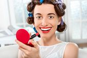 Smiling woman with hair curlers