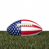 american football ball with usa flag on grass