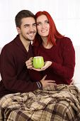 Loving couple with hot drink
