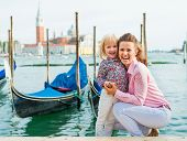 Portrait Of Happy Mother And Baby On Grand Canal Embankment In Venice, Italy