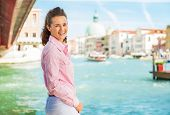 Portrait Of Happy Young Woman Standing On Grand Canal Embankment