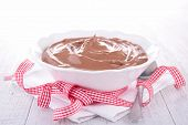 chocolate mousse in bowl and bow