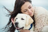 Girl with dog on the beach.