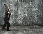 Businessman Using Sledgehammer Cracking Wall Broken On Concrete Floor