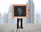 Businessman Holding Chalkboard With Hand-drawn Ideas Equal Money Concept