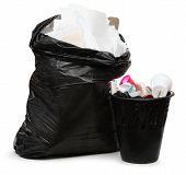 Full Wastebasket And Plastic Bag