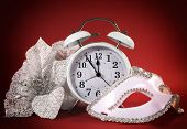 pic of ares  - Happy New Year clock masquerade party mask and festive white flowers on ared background - JPG