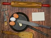 vintage utensils set, skillet, eggs,butter, space for your text on a blank business card