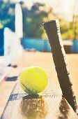 Tennis Racket And Ball On The Bench At The  Court. Soft Art Multicolored Toning