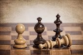 Wooden chess pieces on a grungy background