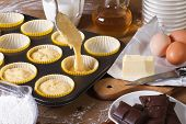 The Process Of Preparing Cupcakes In The Kitchen