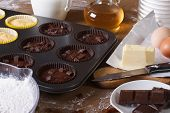 image of cupcakes  - cooking chocolate and vanilla cupcakes close - JPG