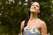 Portrait of a brunette enjoying the sunshine in the park