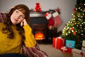 Beauty redhead thinking and relaxing at christmas at home in the living room