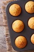Golden Delicious Muffins In Baking Dish Vertical Top View