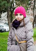 stock photo of girl walking away  - Portrait of beautiful young girl walking down the street  - JPG