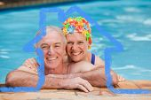 Happy mature couple in the swimming pool against house outline