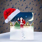 Santa delivery presents to village against grey reindeer pattern