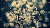 Happy new year against shimmering light design on black