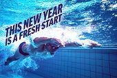 Fit swimmer training by himself against new year fresh start
