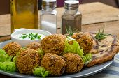 image of cumin  - Health crunchy falafel with mint and garlic dip naan bread with cumin and herbs - JPG