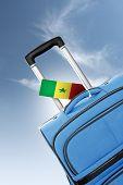 Destination Senegal. Blue Suitcase With Flag.