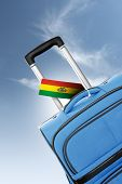 Destination Bolivia. Blue Suitcase With Flag.