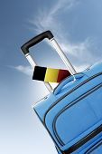 Destination Belgium. Blue Suitcase With Flag.