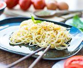 spaghetti dinner with chopsticks close up