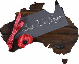 foto of tribute  - Australian Gallipoli Centenary WWI April 1915 tribute with Lest We Forget message and red poppy lapel pin badge inside map of Australia - JPG