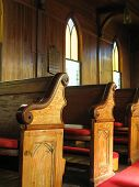 stock photo of pews  - late afternoon sunlight falls across old cypress pews in a small town american church built in the early 1830s - JPG