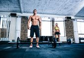 picture of barbell  - Fit man and woman workout with barbell at gym - JPG