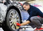 stock photo of alloy  - Man worker washing car - JPG